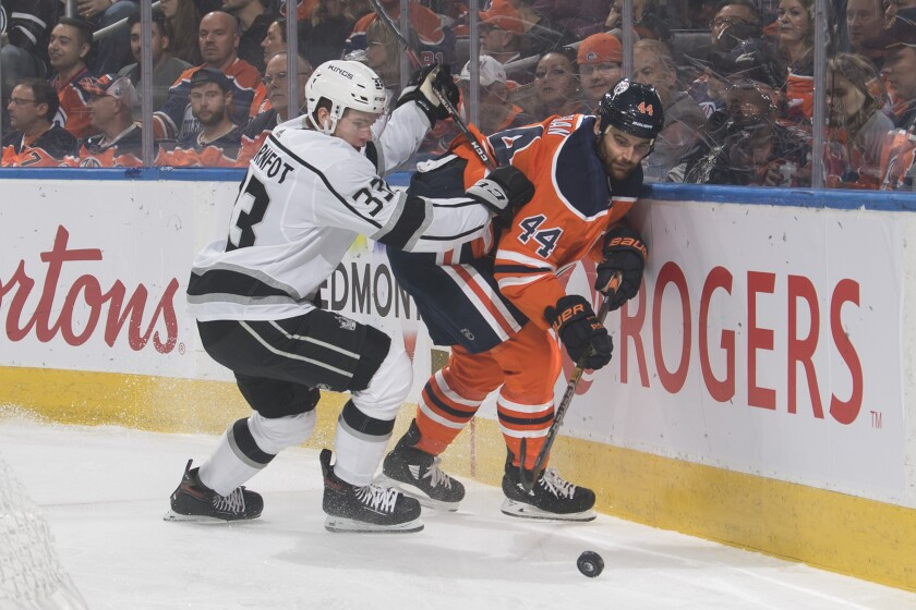 The Kings' Tobias Bjornfot, left, and the Oilers' Zack Kassian near the boards in Edmonton on Oct. 5.