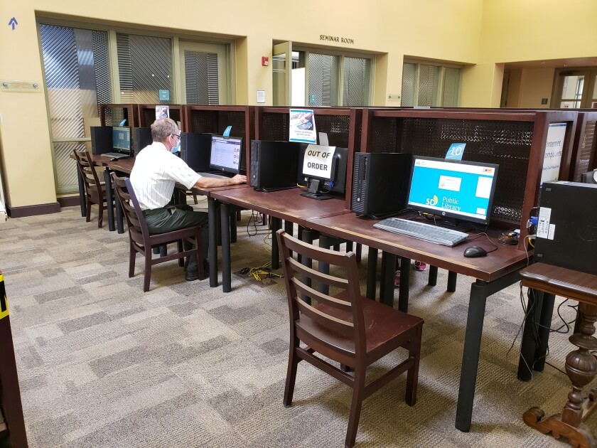 A visitor uses a computer at the La Jolla/Riford Library in October.
