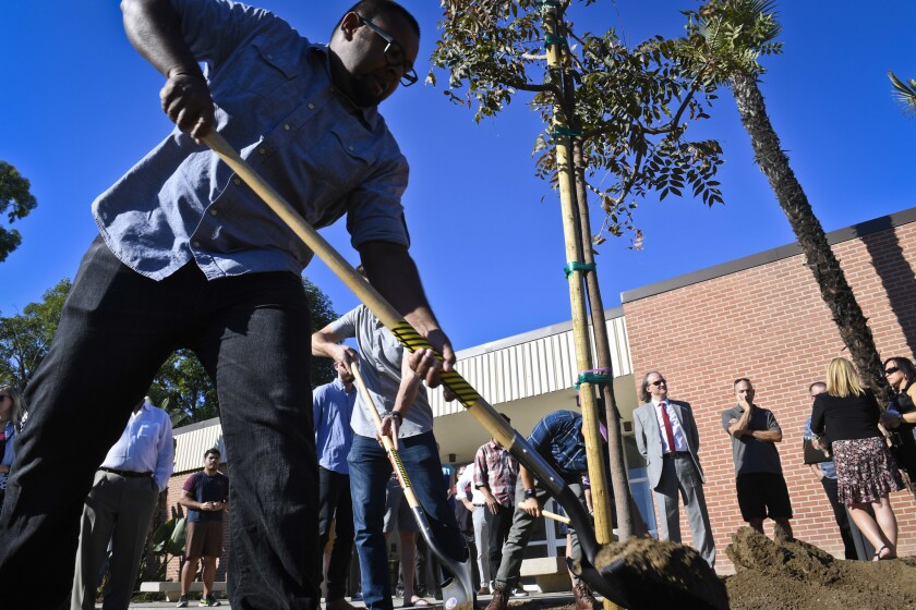 Niran Jayasiri helps shovel dirt around a Chinese pistachio tree dedicated at Cal State Long Beach on Sunday in memory of Nohemi Gonzalez, a student who was the only American killed in the Paris terror attack one year ago to the day.
