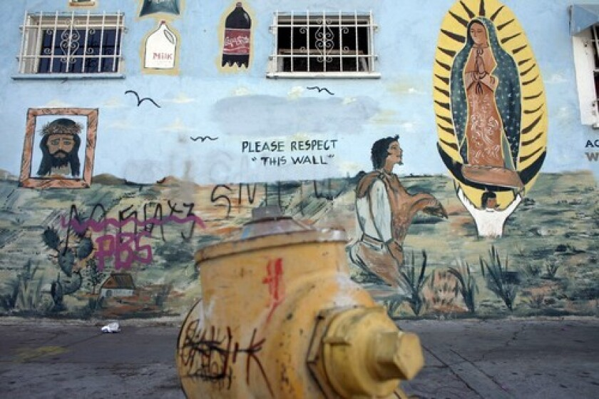 """A graffiti-marred wall in South Los Angeles. City Atty. Carmen Trutanich wants to make it a crime for documented """"taggers"""" to associate in public."""
