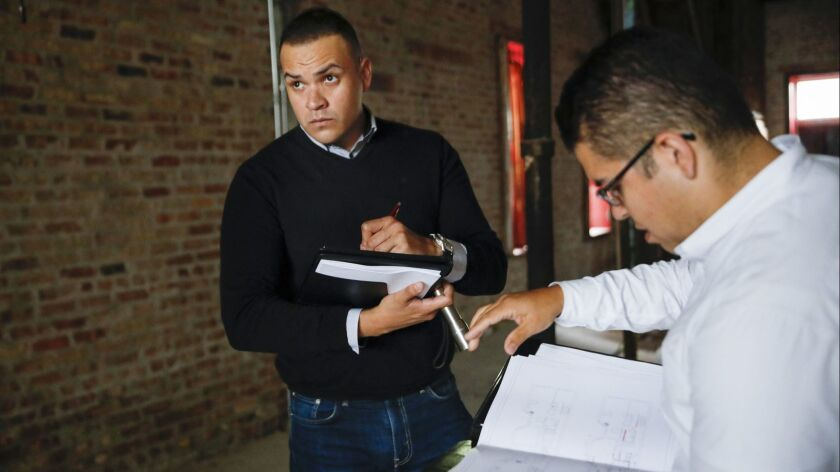Recent college graduate Gabriel Villagomez, left, has an internship with real estate broker and consultant Miguel Chacon, but he's worried about what he'll do when his student loans start coming due.