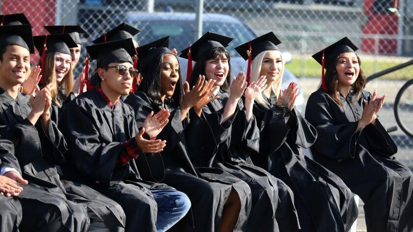 Jubilant Monterey High School graduates cheer during the school's 2019 graduation ceremony on Monterey's campus in Burbank on Friday.
