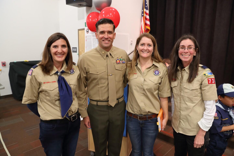 Scoutmaster April Wurster, guest speaker Major Nate Green, den leader Caryn McCall, den leader Tracey Block