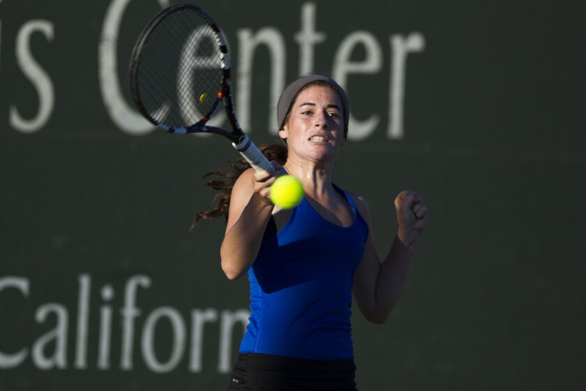 La Jolla Country Day's Jennifer Richards hits a forehand against San Deguito Academy's Jennifer Kerr during the first set.