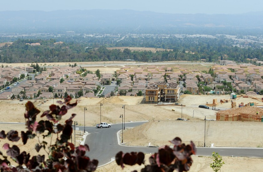 New homes under construction at Toll Brothers' Westcliffe development are seen in Porter Ranch. A shortage of new housing has helped push up prices in Southern California.