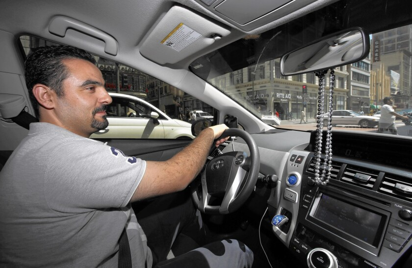 Uber driver Joseph Youssef drives through downtown Los Angeles.