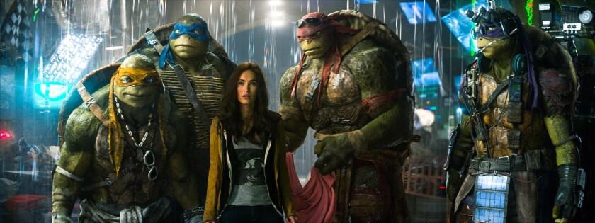 "From left, Michelangelo, Leonardo, Megan Fox as April O'Neil, Raphael and Donatello in ""Teenage Mutant Ninja Turtles."""