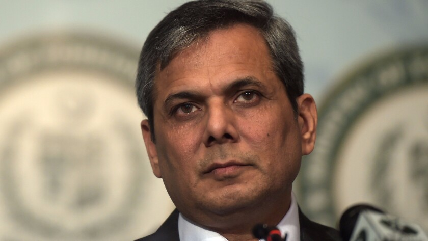 "Nafees Zakaria, spokesman for the Pakistan Foreign Ministry, listens at a news conference in Islamabad. Prime Minister Nawaz Sharif condemned the ""naked aggression of Indian forces."""