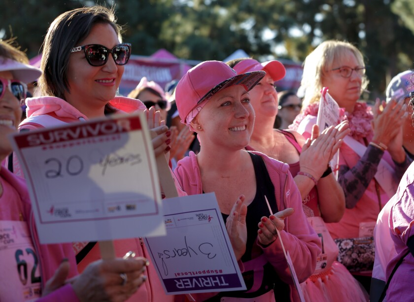 Cancer survivors were invited to the front of the stage to take part in the opening ceremony celebration for the Susan G. Komen Race for the Cure 2019 at Balboa Park on Sunday.