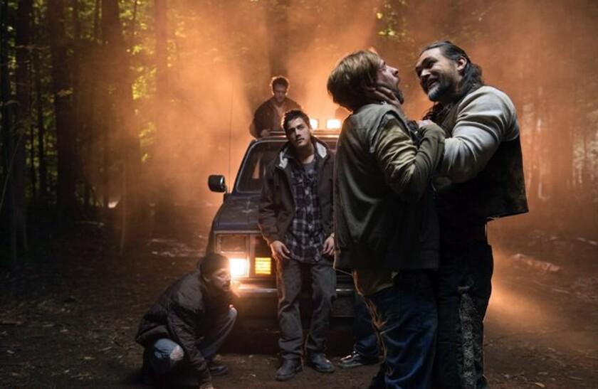 "Jason Mamoa, far right, in ""Wolves."""