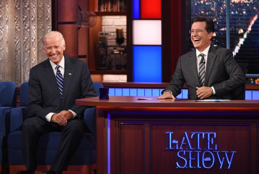 """Then-Vice President Joe Biden laughs during a 2015 taping of """"The Late Show With Stephen Colbert."""""""