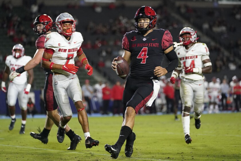 San Diego State quarterback Jordon Brookshire steps into the end zone on a first-half touchdown for the Aztecs.