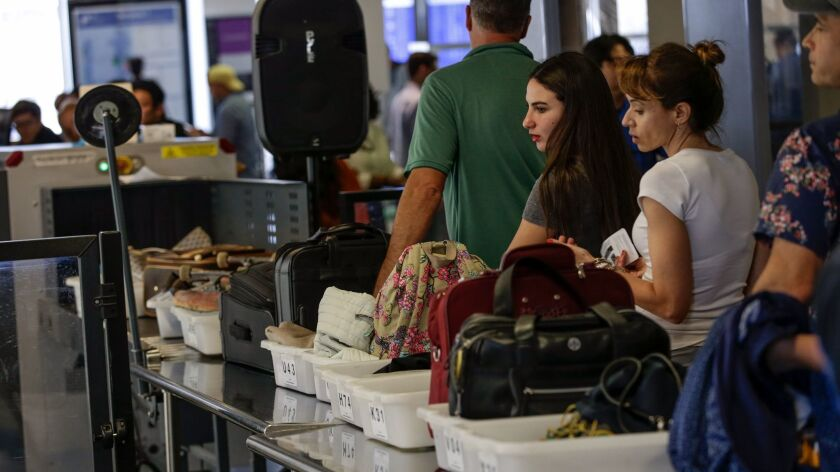 LOS ANGELES, CA, FRIDAY, MAY 27, 2016 - Memorial Day weekend travelers line up at a TSA checkpoint a