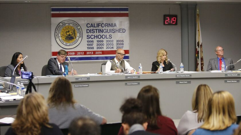 Ocean View School District board members listen to public comments during a meeting in 2018. The district will keep its campuses closed the rest of this school year because of the coronavirus outbreak.