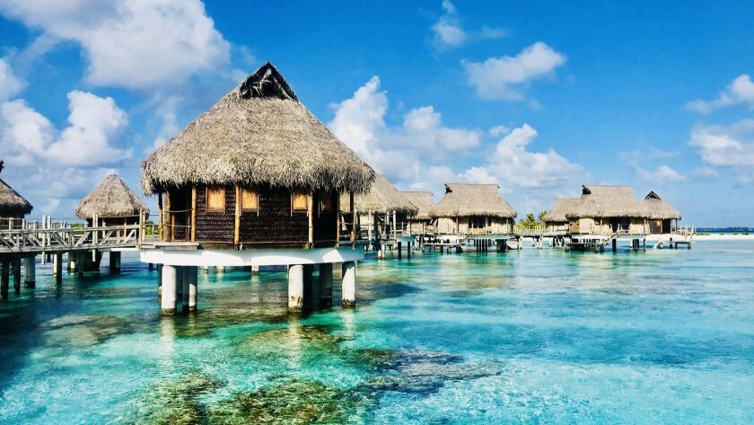 Overwater bungalows at Tikehau Pearl Beach Resort