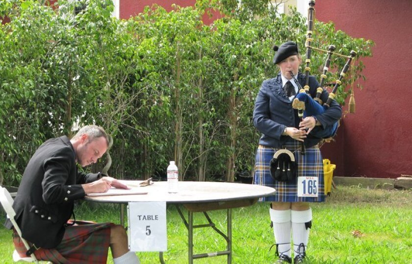 A bagpipe player performed while a judge marked scores at last year's Harry Moore Memorial Solo Piping & Drumming Competition in Riverside.