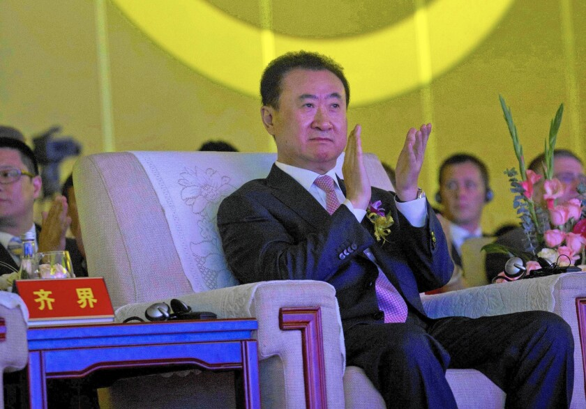 """Chinese billionaire Wang Jianlin, who owns China's biggest cinema chain, is looking to buy Lionsgate, the independent studio behind the lucrative """"Hunger Games"""" and """"Twilight"""" franchises."""