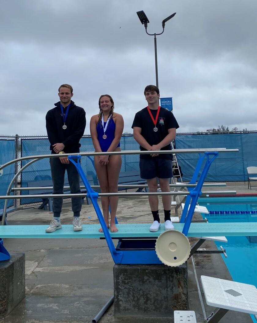 From left, Caden Clark, a junior; Gracey Michaelis, a senior; Matthew Thomas, a junior.