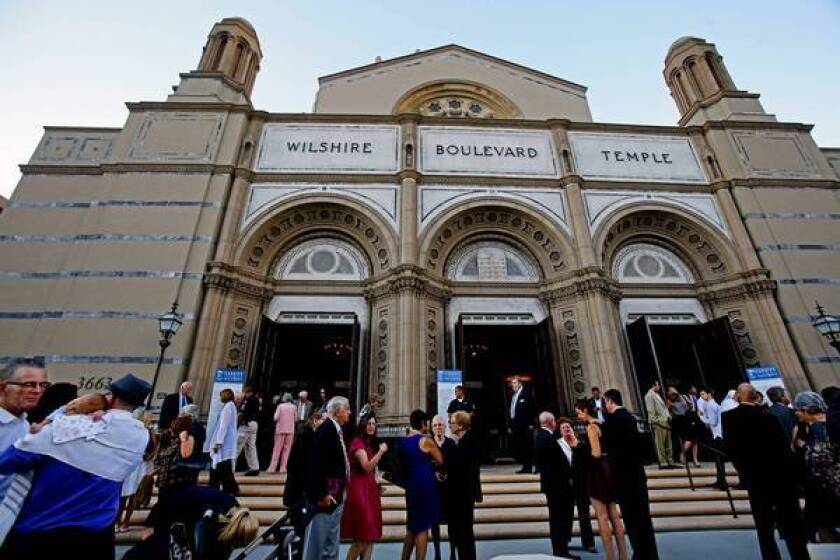 Congregants talk after Rosh Hashana services at the Wilshire Boulevard Temple.