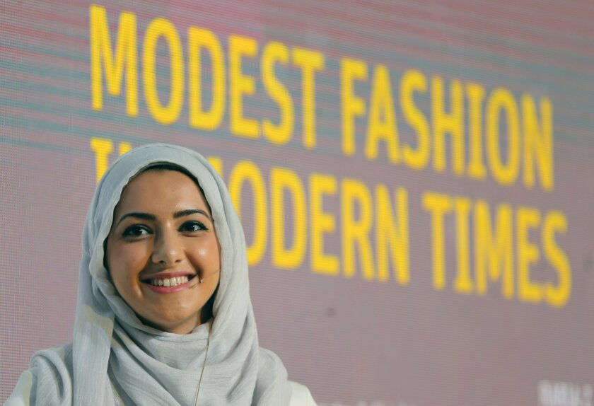 """In this Oct. 5, 2014 photo, Summer Albarcha, owner of photo-sharing Instagram account """"Hipster Hijabis"""", talks during a Fashion Forward session in Dubai, United Arab Emirates. By fusing both their sense of fashion with their faith, Muslim women are reinterpreting traditional notions of what it means to dress conservatively. Some have also pioneered businesses around this growing demand, finding unexpected supporters among some mainstream brands, as well as conservative Christian and Orthodox Jewish women. (AP Photo/Kamran Jebreili)"""