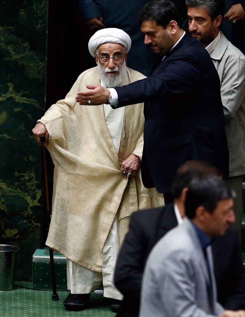 The conservative Ayatollah Ahmad Jannati, chairman of the Iranian Assembly of Experts, arrives for the inauguration of the new Iranian parliament, in Tehran, on Saturday.