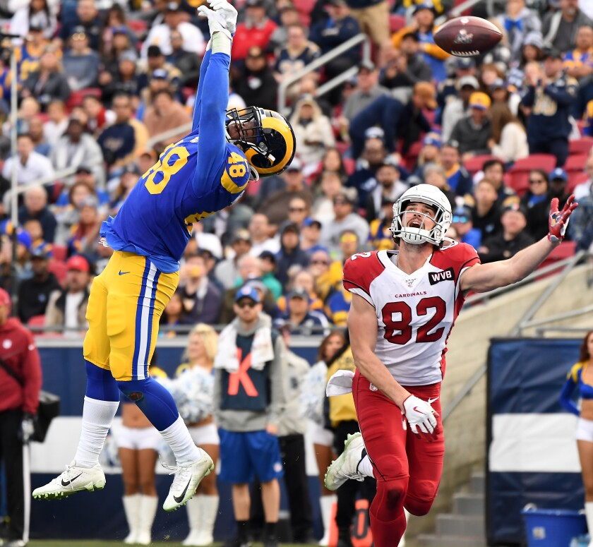 Rams linebacker Travin Howard deflects a pass in the end zone against the Cardinals last season.