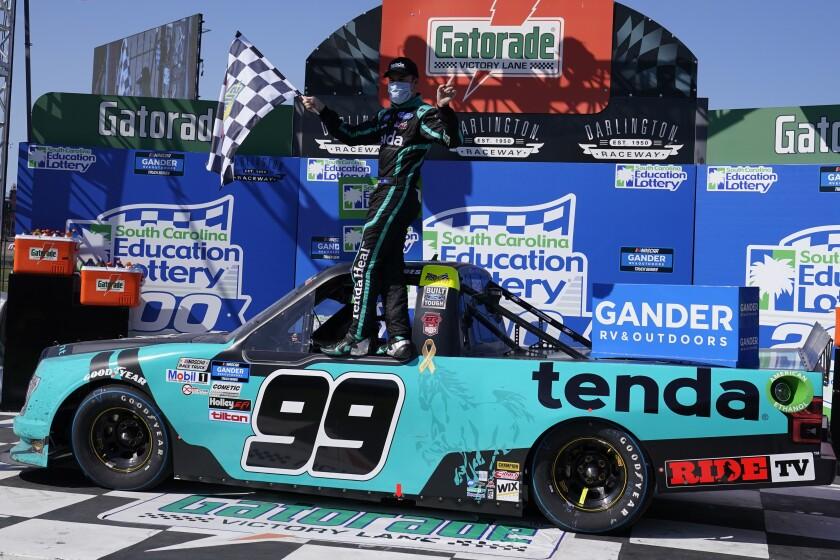 Ben Rhodes (99) celebrates after a win after a NASCAR Truck race Sunday, Sept. 6, 2020, in Darlington, S.C. (AP Photo/Chris Carlson)