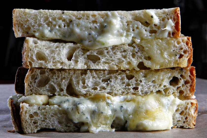 Shown here is the bakery's Almost Grilled Cheese, which featured triple cream French brie and crumbled Gorgonzola cheese on oven-toasted rosemary olive oil bread. It regularly offered more than 20 varieties of handmade artisan bread.