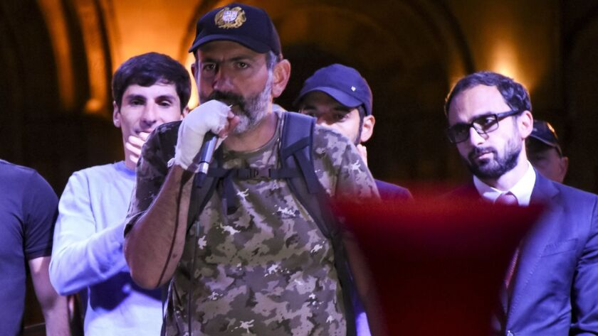 Armenian protest leader Nikol Pashinian, center, speaks to protesters gathered at Republic Square in Yerevan on April 25.