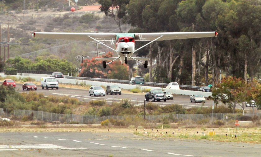 A small plane takes off at Oceanside's airport in the San Luis Rey Valley. In the background is nearby state Route 76.