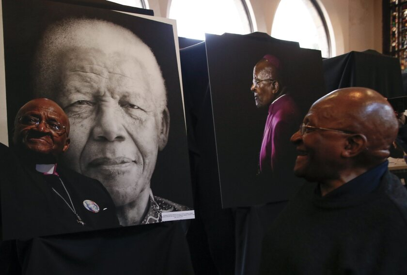 South African Nobel PeacePprize laureate Archbishop Desmond Tutu, right, at a Cape Town photo exhibit in August depicting his public and private life, including his alliance with late apartheid fighter Nelson Mandela.
