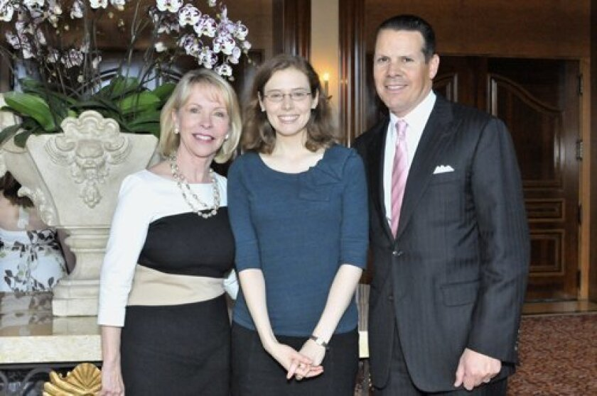 Chapter leader Gayle Allen of Northern Trust, author Madeline Miller, John Ippolito of Northern Trust. Photo/McKenzie Images
