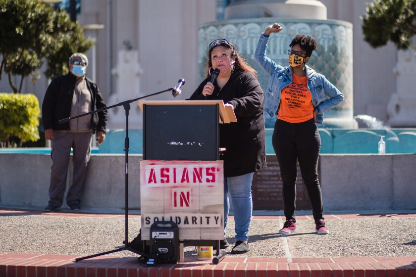 DJ Kuttin Kandi speaks at a Press Conference at Waterfront Park in downtown San Diego on March 19, 2021.