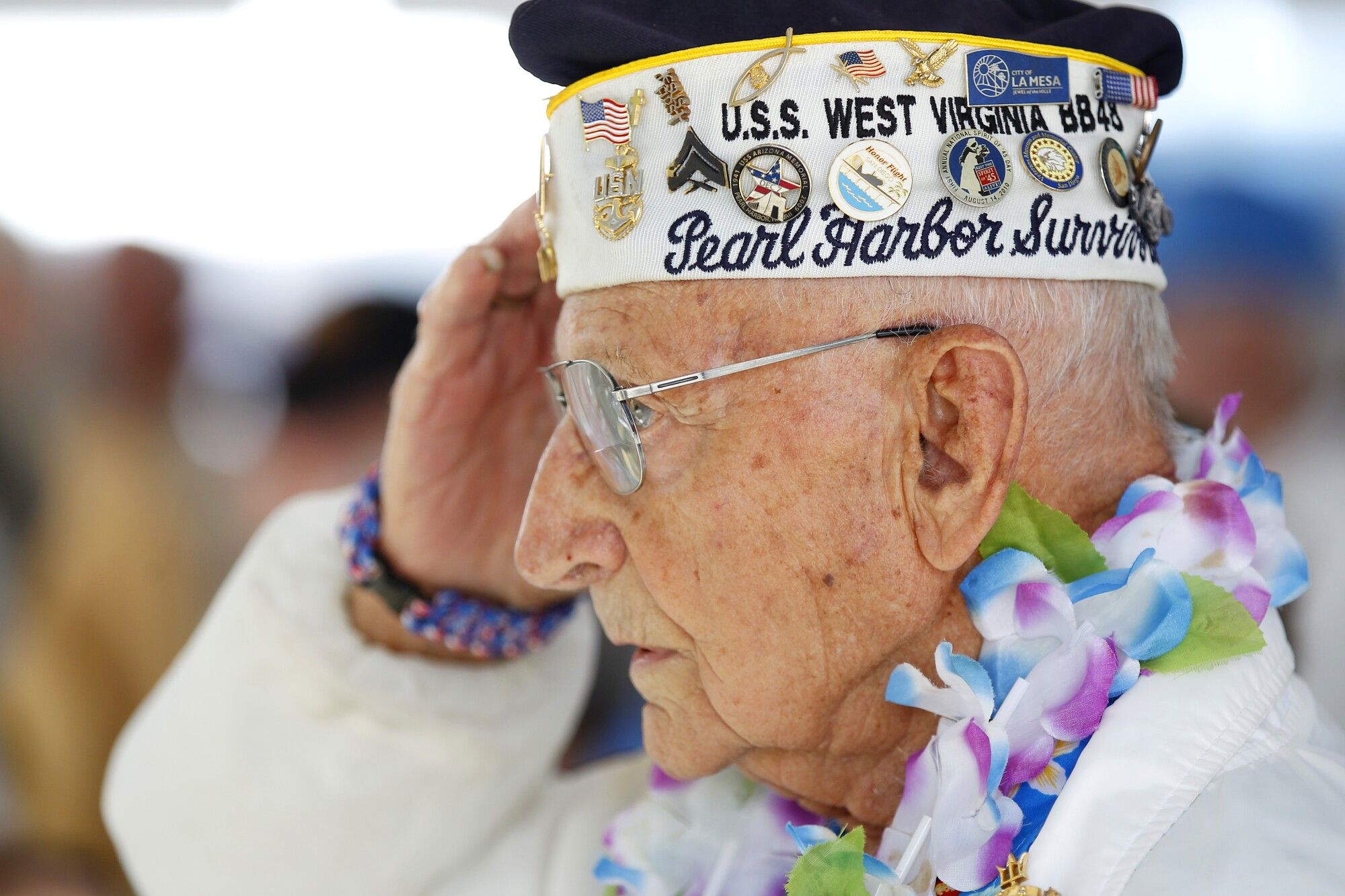 Stu Hedley, 94, salutes during the National Anthem during Balboa Park's Veterans Museum Spirit of '45 Day on August 16. 2016