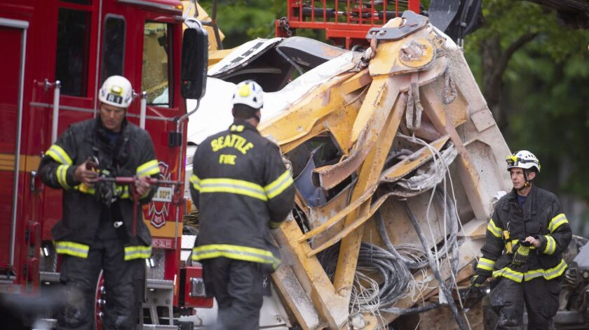 Emergency crews work the scene of a construction crane collapse near the intersection of Mercer Stre