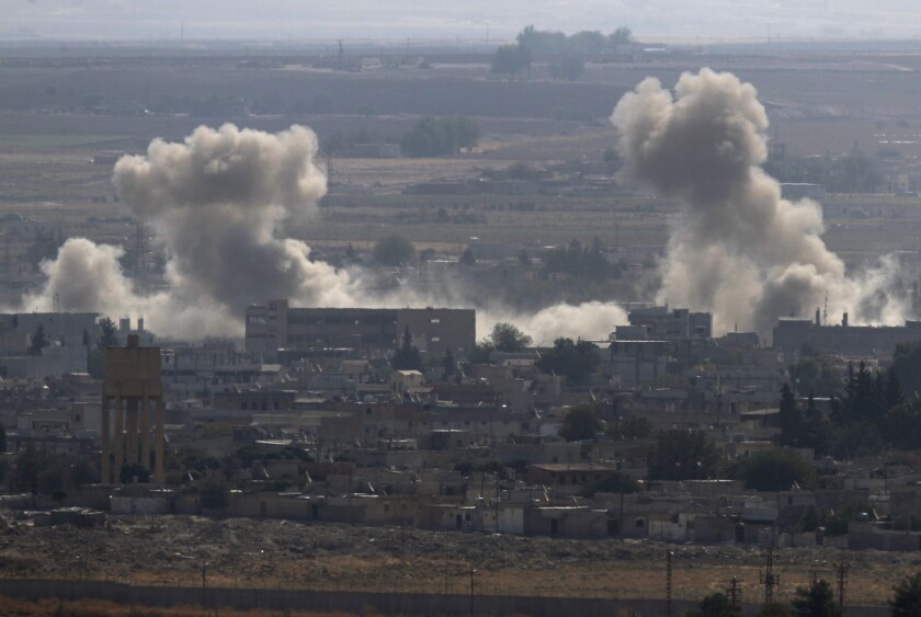 Smoke and dust billows from targets in Ras al-Ayn, Syria, caused by bombardment by Turkish forces, on Tuesday.