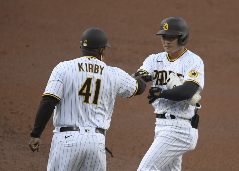 The Padres' Ha-seong Kim is congratulated by Wayne Kirby