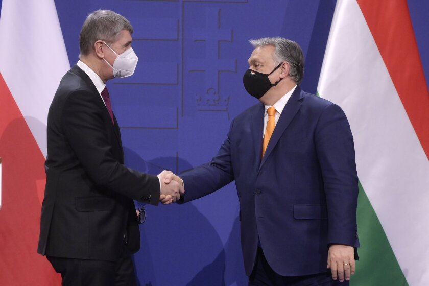 Hungarian Prime Minister Viktor Orban, right, and his Czech counterpart Andrej Babis shake hands prior to their press conference in Orban's office in Budapest, Hungary, Friday, Feb. 2021. (Szilard Koszticsak/MTI via AP)