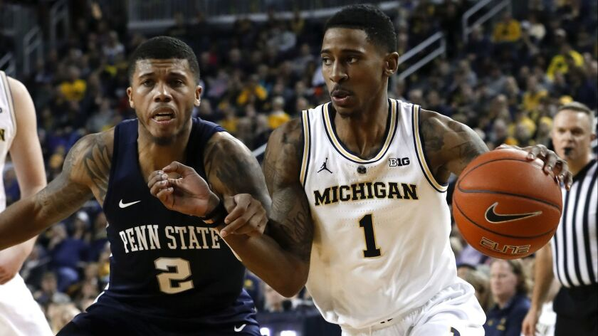 Michigan guard Charles Matthews (1) drives on Penn State guard Myles Dread (2) in the second half of