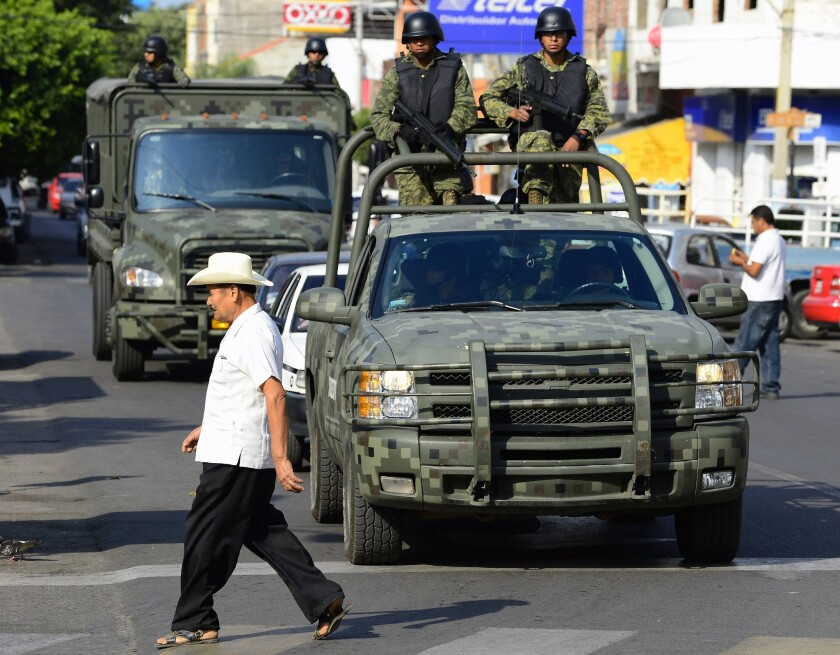 Mexican soldiers patrol the streets of Apatzingan, in Michoacan state.