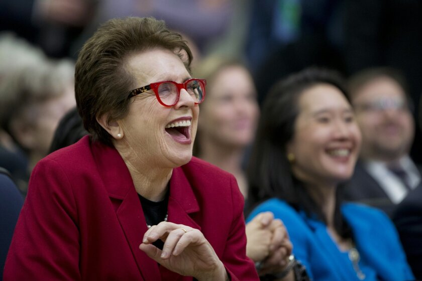 FILE - In this Jan. 29, 2016 file photo, tennis legend Billie Jean King, left, laughs, reacting to President Barack Obama's remarks at a gathering in the Eisenhower Executive Office Building on the White House complex in Washington.  King was the keynote speaker Wednesday, Feb. 10, 2016 at an annua