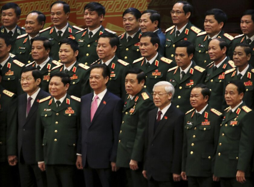 Vietnamese President Truong Tan Sang, front row left, Prime Minister Nguyen Tan Dung, front row third left, and Communist Party General Secretary Nguyen Phu Trong, front row third right, pose for a group photo with the Army generals after the election for the new Central Committee in Hanoi, Vietnam, Tuesday, Jan. 26, 2016. Trong secured more than 80 percent of the votes from delegates at a party congress to win election to the Central Committee, one of the two pillars of the ruling establishment, several delegates said. (AP Photo/Na Son Nguyen)