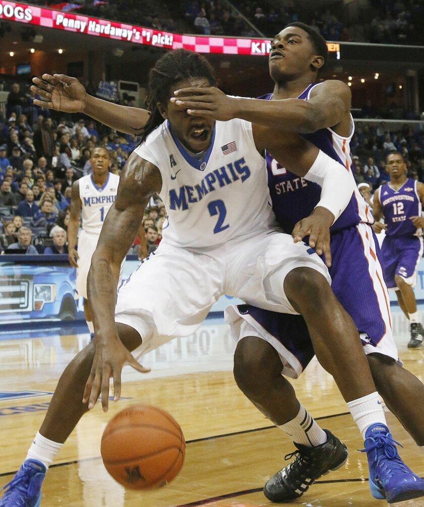 Northwestern State guard Zikiteran Woodley (23) defends against Memphis forward Shaq Goodwin (2) in the first half of an NCAA college basketball game on Saturday, Dec. 7, 2013, in Memphis, Memphis won 96-76. Tenn. (AP Photo/Lance Murphey)