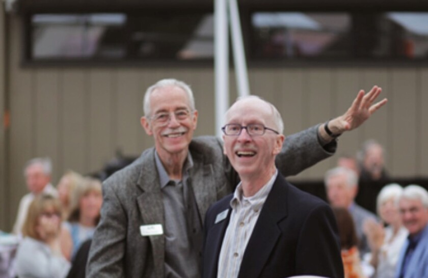 Wayne Peterson, left, and Terry Smith are honored at a Laguna College of Art and Design event.