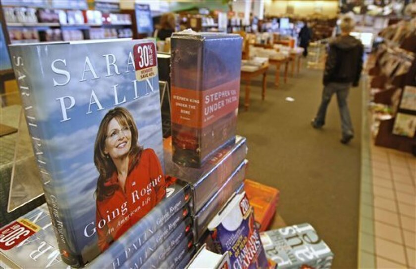 """FILE - In this Nov. 17, 2009 file photo, copies of former Republican vice presidential candidate Sarah Palin's new book """"Going Rogue"""" are on display the Barnes & Nobel Bookstore in Orem, Utah. (AP Photo/George Frey, file)"""