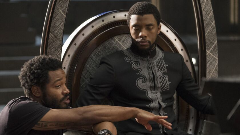 "Director Ryan Coogler on the set of ""Black Panther"" with star Chadwick Boseman."