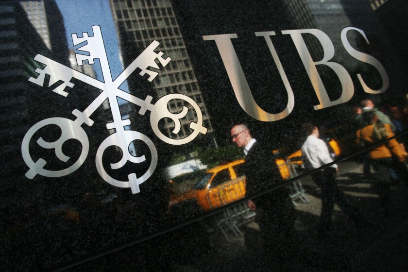 Swiss bank UBS said it is paying $545 million to settle U.S. cases of market manipulation.