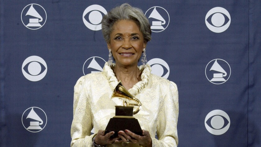 """Nancy Wilson poses with her Grammy Award for best jazz vocal album for """"R.S.V.P. (Rare Songs, Very Personal)"""" at the awards ceremony at Staples Center in 2005."""