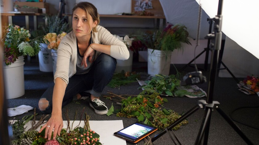 BloomThat stylist Stevie Wazna-Blank arranges flowers during a photo shoot of an upcoming lookbook at the company's headquarters in San Francisco.