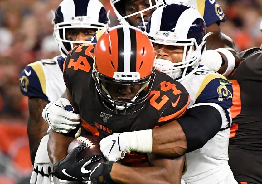 Rams defensive tackle Aaron Donald tackles Cleveland Browns running back Nick Chubb.